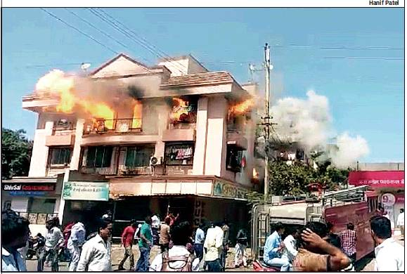 A fire broke out in two flats of a two-storey building in Palghar following an LPG cylinder explosion on Wednesday. Two fire tenders were rushed to the site to contain the flames. No one was injured
